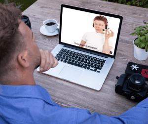 a man watching a webinar